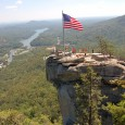 In 1885 Chimney Rock began its long history as a tourist attraction when the first stairway to its 315-foot granite summit was completed. Missouri native Lucius Moore purchased the spectacular rock outcropping overlooking Hickory Nut Gorge in 1902.
