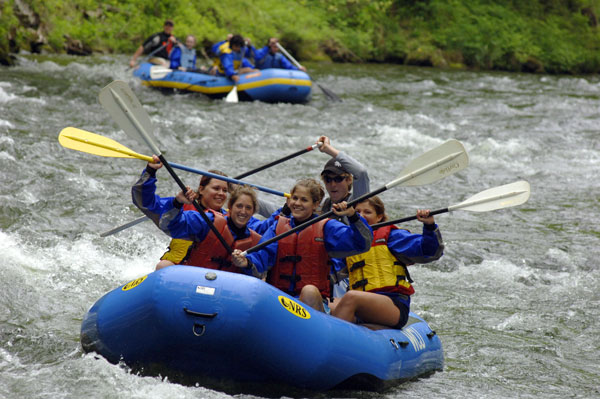 high fives among whitewater rafters