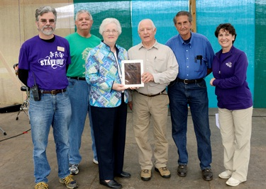 Officers from the Jackson County Genealogical Society accept a 2012 Mountain Heritage Award from Scott Philyaw (far left), director of WCUs Mountain Heritage Center, and Susan Belcher (far right), wife of WCU Chancellor David O. Belcher. Representing the society are (from left) Kenny Nicholson, president; Ruth Shuler, office manager; and Bud Cantrell and Bill Crawford, vice presidents. 