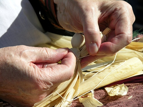 Annie Lee Bryson working on a traditional corn husk doll.