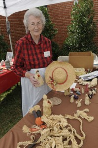Annie Lee Bryson with a sampling of her cornshuck crafts at Mountain Heritage Day.