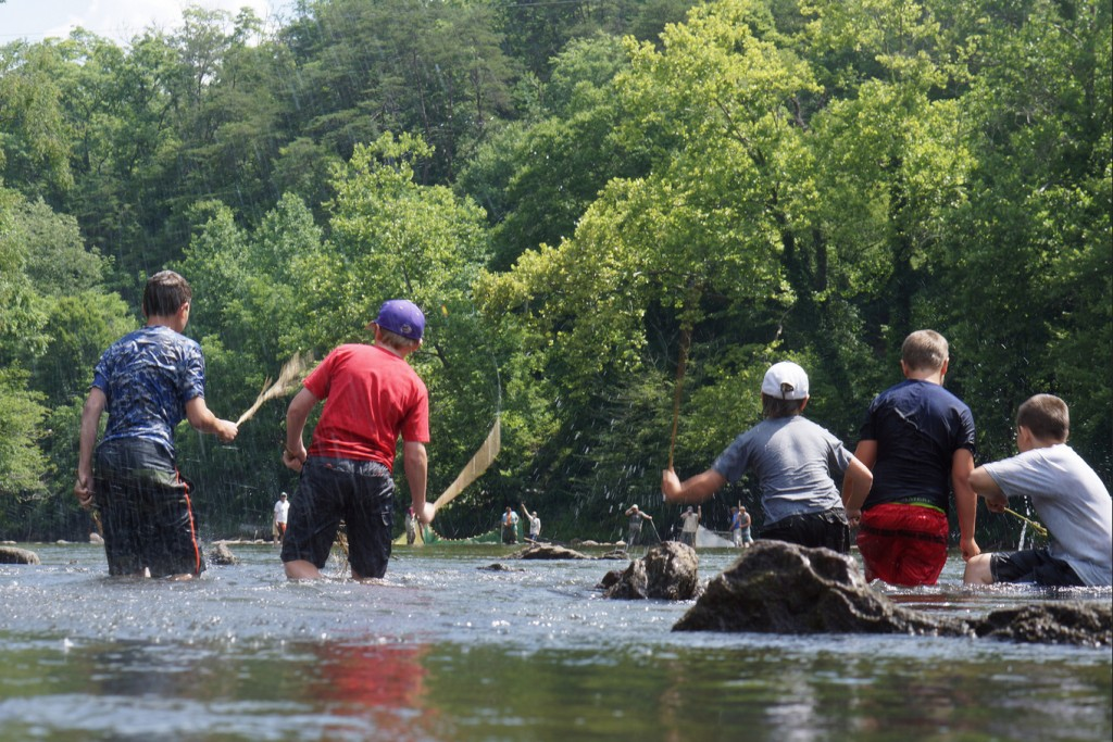 A re-enactment of driving fish into a trap at the end of a weir. Courtesy U.S. Fish and Wildlife Service.