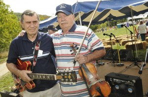 """Two Cherokee County natives, fiddler Gar Mosteller (right) and guitarist Doyle Barker, were named recipients of WCU's Mountain Heritage Awards during a ceremony at WCU's Mountain Heritage Day. The duo has performed """"Appalachian swing"""" music at the festival since 1990. (WCU photo by Ashley T. Evans; 9-27-08)"""